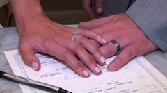 Married couples hands on the marriage certificate Stock Footage
