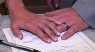 Stock Video Footage of Married couples hands on the marriage certificate