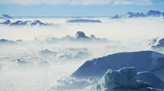 Freezing Air Lying Between Ice Floes & Icebergs Stock Footage