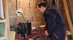 Carpenter scrape on the lathe a piece of furniture Stock Footage