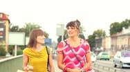Happy female friends with shopping bags walking in the city, steadycam shot HD Stock Footage