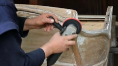 Carpenter sanding piece of furniture Stock Footage