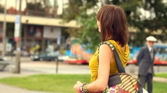 Two female friends meeting after shopping in the city, steadycam shot Stock Footage