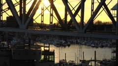Sunset across False Creek, looking under Granville Bridge Stock Footage