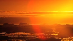 Radiant Setting Sun over Melting Ice Floes - stock footage