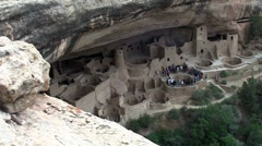 Medium-shot of the ruins of Native American cliff dwellings in Mesa Verde - stock footage