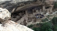 Medium-shot of the ruins of Native American cliff dwellings in Mesa Verde Stock Footage