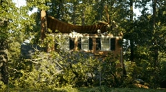 Hurricane aftermath - tree knocked roof off of house (sequence) - stock footage