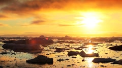 Golden Sunset over Melting Ice Floes Stock Footage