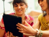 Happy female friends with tablet computer in restaurant, steadycam shot Stock Footage