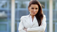 Attractive young caucasian business woman outside office building Stock Footage