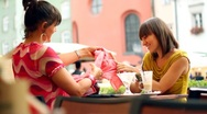 Two female friends after shopping in restaurant, steadycam shot HD Stock Footage