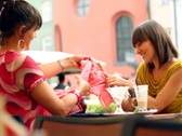 Two female friends after shopping in restaurant, steadycam shot NTSC Stock Footage