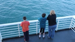 People standing at railing on ferry ride to Kodiak Island(HD) c - stock footage