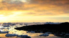 Pan Sunset View of Melting Ice Floes Stock Footage