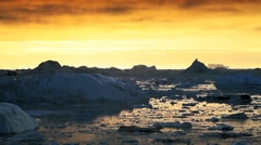 Ice Floes at Sunset in Moving Water Stock Footage