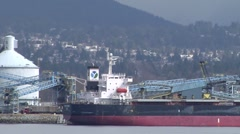 Pan across Burrard Inlet at heavy industry Stock Footage