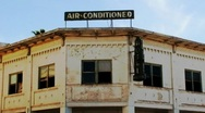 Stock Video Footage of Old Border Town Hotel Air-Conditioned Sign 2
