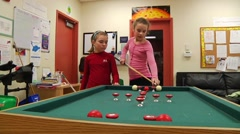Little girls playing pool Stock Footage