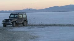 Jeep off roading at Salt Flats in slow motion - stock footage