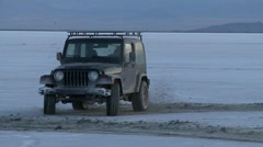 Jeep off roading at Salt Flats in slow motion 2 - stock footage