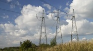 Stock Video Footage of high voltage power pylons.