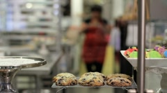 Woman puts pie on display at a bakery Stock Footage