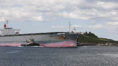 Coal freighter with tugboats Stock Footage