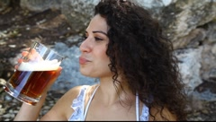 Young pretty woman tastes and appreciates beer in big glass MRL Stock Footage