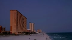 Resorts at sunset along the emerald coast beaches in Panama City Beach Stock Footage