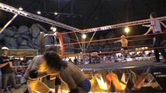 Pro wrestling match - Brawling outside ring & dive through ropes to floor HD - stock footage
