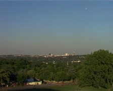 Zoom out of Johannesburg Sandton Skyline from green, leafy suburb 2005, GFSD - stock footage