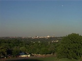 Stock Video Footage of Zoom out of Johannesburg Sandton Skyline from green, leafy suburb 2005, GFSD