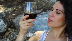 Young pretty woman tastes and appreciates red wine MRL Stock Footage