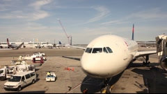 New York City, JFK airport at gates, Delta aircraft, and support equipment. Stock Footage