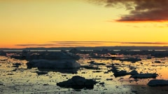 View of Golden Sunset over Ice Floes Stock Footage