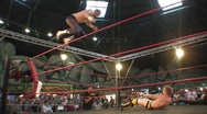 A pro wrestler misses a dive off the top rope HD Stock Footage