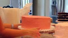 Interesting baker preparing a wedding cake. Stock Footage