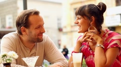 Couple having a meal at an outdoor restaurant, steadicam shot Stock Footage