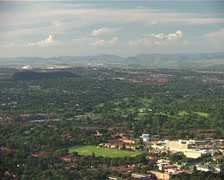 Slow Zoom out from Randburg on Northcliff Hill GFSD - stock footage