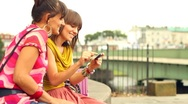 Stock Video Footage of Two female friends with mobile phone in the city, outdoors, steadycam shot
