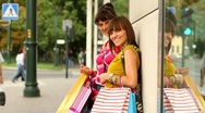 Stock Video Footage of Happy young female friends with shopping bags in the city, steadycam shot