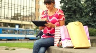 Stock Video Footage of Happy shopping woman with tablet computer in the city, steadycam shot