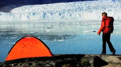 Lone Hiker & Tent by Arctic Glacier Stock Footage