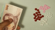 Thai Baht THB, Counting Drugs and Money, Health Care, Colorful Pills Stock Footage