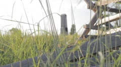 Stock Footage - Low angle on Gettysburg Battlefield - Fence, grass, monument Stock Footage