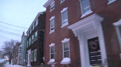Driving in quaint, snowy New England town Stock Footage