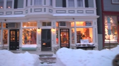 Quaint, snowy New England town during Christmas Stock Footage