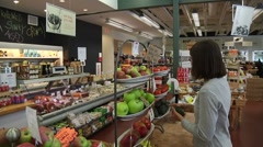 Woman grocery shopping for fruit and vegetables Stock Footage