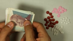 Cambodian Riel KHR, Counting Drugs and Money, Health Care, Colorful Pills - stock footage